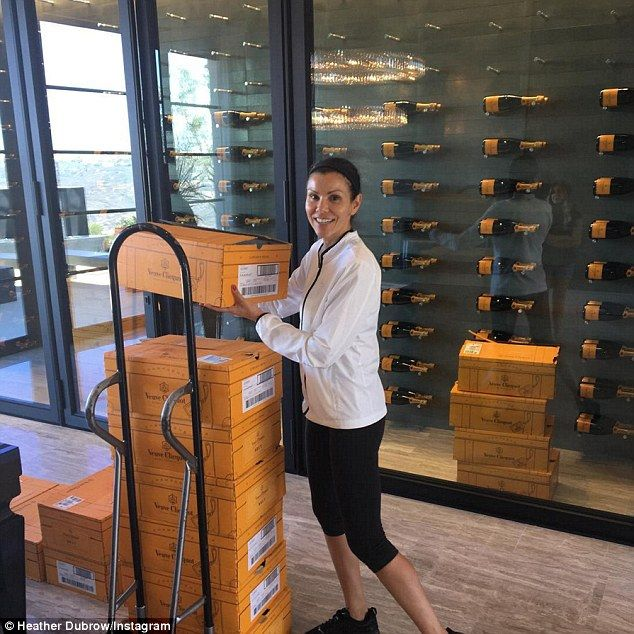 The essentials: Heather Dubrow christened her new mansion with champagne - cases of it - on Tuesday, stocking up her wine fridge with thousands of dollars of Veuve Clicquot