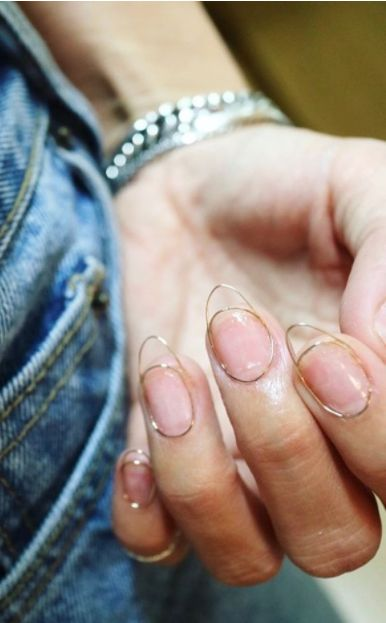 Eun Kyung Park, the founder of Unistella salon and creator of incredibly intricate nail art, has blessed us all with a new trend that takes minimalist manicures to an entirely new level: wire nails. (image via Instagram: nail_unistella)