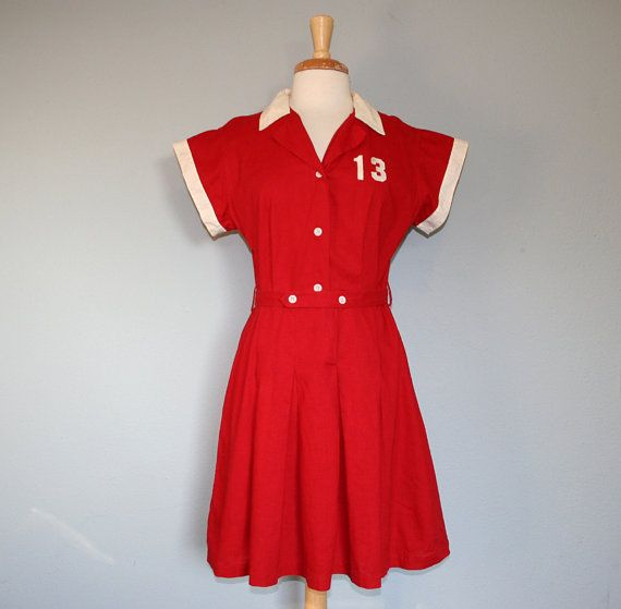 1940s BASEBALL DRESS- This dress represents the type of baseball uniforms women wore in the 1940s. Many wore women started playing baseball in the 40s because a large portion of Major League players went to fight in the war (37) The first All-American girls' baseball team was formed in 1943 (38).