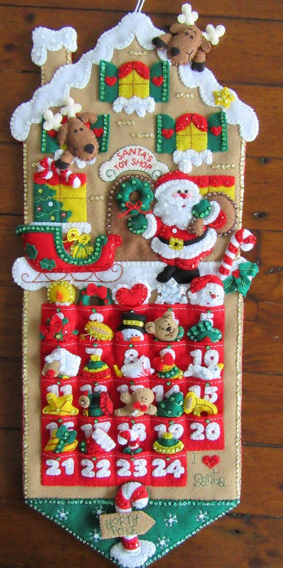 Santas Toy Shop advent Calendar.  This Calendar measures 11 x 26 in size and includes 24 little stuffies that fit into each pocket to count off the days until Christmas. This calendar is lined on the back to hide the stitches and comes with a drawstring bag to hold the tiny ornaments.  I hand cut and stitch my projects with love and care. All beads and sequins are also attached by hand, no glue is used on any of my creations. Stitched in a smoke free home.