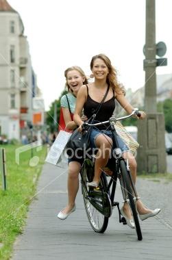 City Girls on a Bike Royalty Free Stock Photo