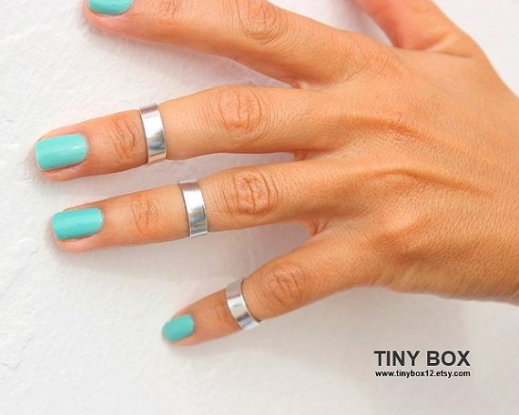 Silver above the knuckle rings.