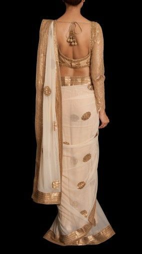 Pretty white and gold saree or sari with blouse. #IndianFashion: