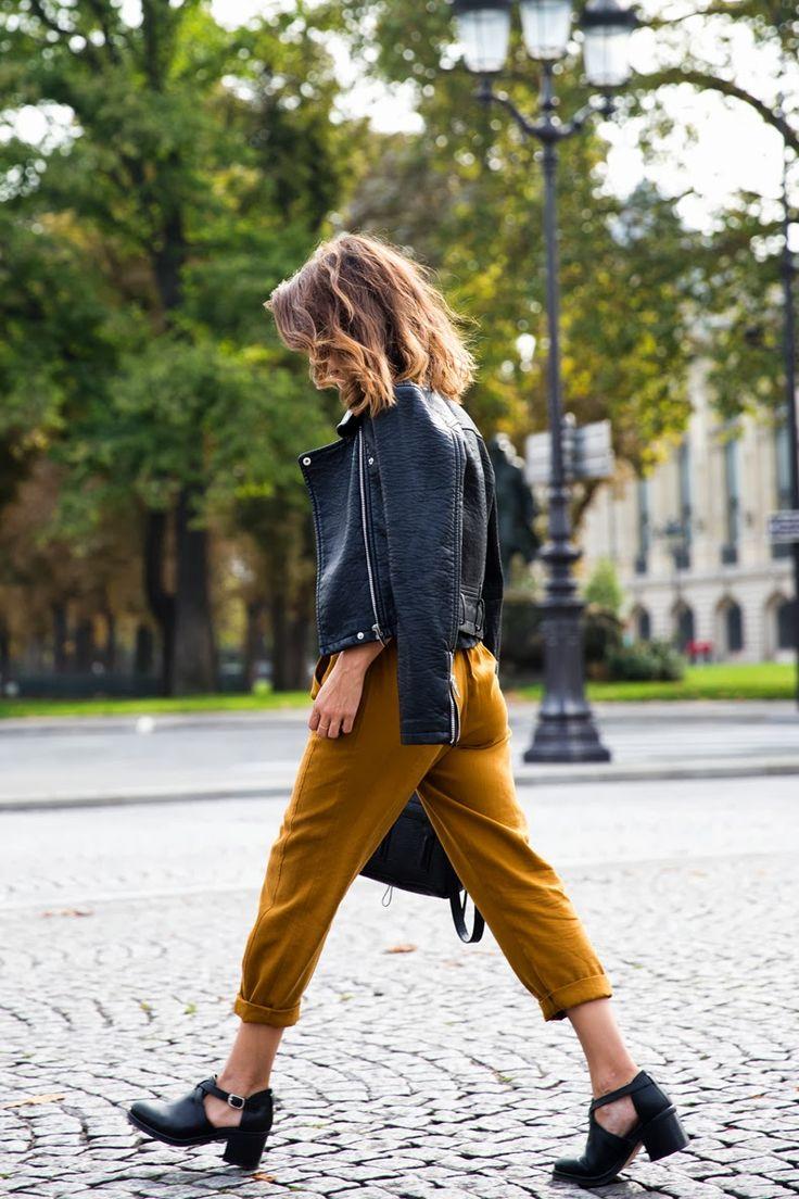 Mustard pants and cutout shoes.