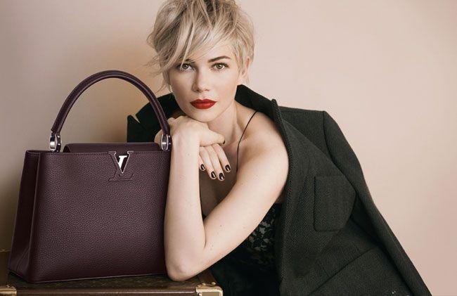 Discreta e femminile. L'ultima creazione Louis Vuitton, qui mostrata tra le braccia di Michelle Williams, prende ispirazione da tutto il savoir-faire della Maison.