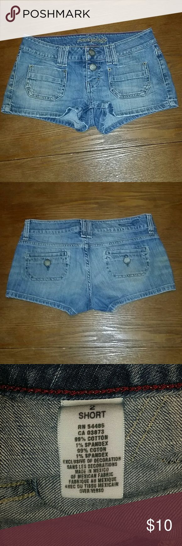 AE Ameican Eagle 2 Short Denim Button Fly Shorts Factory faded short shorts by AE. Size 2. Lowrise. Short 2.25 inch inseam. 30 inch waist. Belt loops, front & back pockets, button fly. Distressed hem. American Eagle Outfitters Shorts Jean Shorts