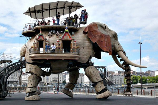 the Great Elephant is 12 meters high, weighs 45 tons, can carry 49 people on its back for a 45-minute promenade along the Loire River, and is powered by the motor from a city bus. But the not-in-Kansas-anymore part is that it trumpets, wags its tail, blinks its eyes, sprays people with water from its trunk, and has been known to pee on the sidewalk. The beast is but one of the Machines of the Isle of Nantes, a sculptural and mechanical oasis of whimsical creatures inspired by Nantes native Ju...: Ing France, Funny Things, Elephants Power, France Travel, Modern Engine, France Awesome, King Arthur, Engine Art, Cities Bus