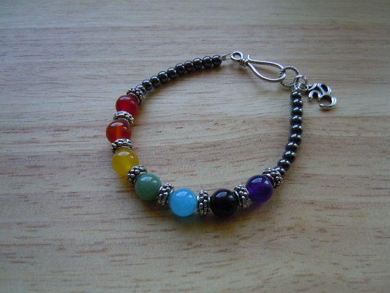 Chakra Balancing Hematite Semi Precious Gemstone Bracelet Om Ohm Charm Reiki Yoga. $14.00, via Etsy.