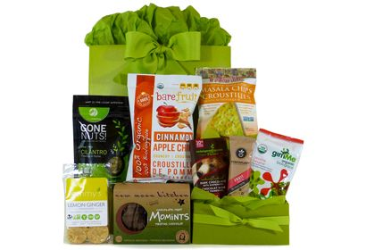 VEGAN LUXURY SNACK BASKET -  A basketful of luxury snacks can make the holidays even more delicious, and this assortment of treats has something to tantalize everyone's taste buds. Chocolate-mint cookies, spiced pistachios, masala chips, and fair trade dark chocolate with raspberries are just a few delights waiting to be unwrapped and devoured. And maybe even shared. Maybe.   at Healthy Gourmet Gifts