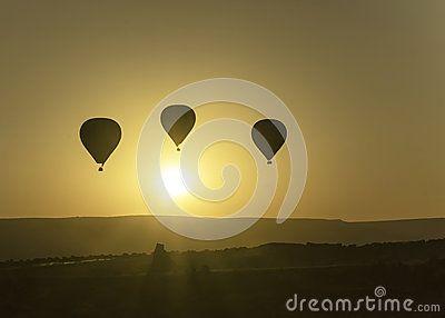 Photo shows flying balloons at dawn over Cappadocia http://www.photokameljurkowski.pl