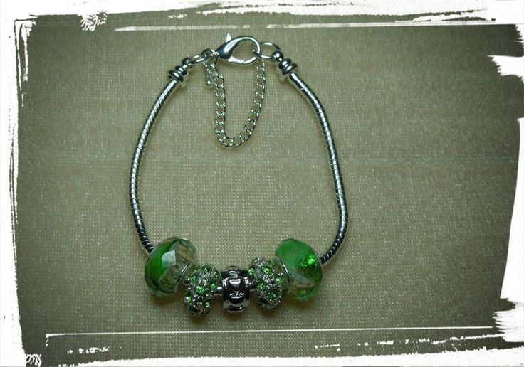 European style glass & silver plated beads... www.facebook.com/creativelywellcreations