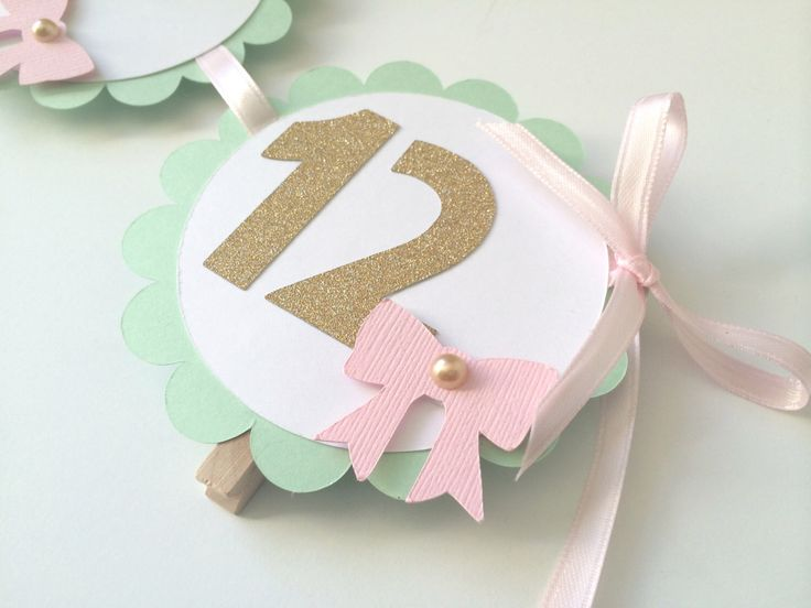 1st Year Photo Banner in MINT, Pink and Gold. Photo Display 1st Birthday. Gold Heart Banner with Photo Clips.Scallop Photo Banner.13 Months by PaperTrailbyLauraB on Etsy https://www.etsy.com/listing/204521562/1st-year-photo-banner-in-mint-pink-and