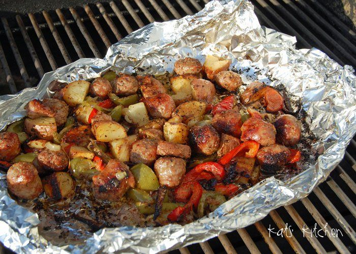 GRILLED SAUSAGE AND PEPPERS === I was trying to come up with a super easy quick meal the other night and threw this together.  It worked out great and was a 'one' tinfoil meal!  1 onion, sliced 1 green pepper, sliced 1 red pepper, sliced 3-6 red potatoes, medium cubed 3-6 Italian/Polish sausage, cut into chunks olive oil/spray seasoning to taste =====