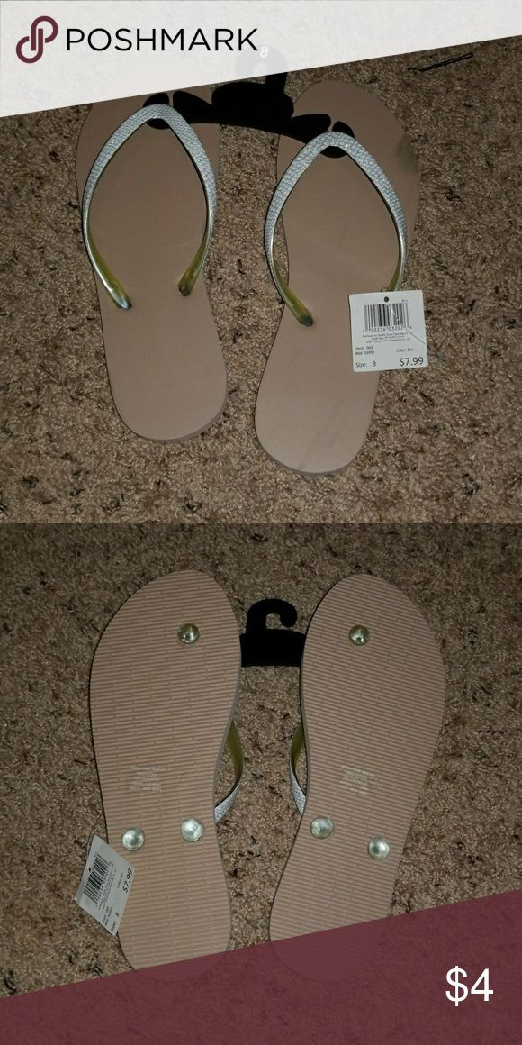Beige flip flops Nwt beige flip flops with white band Shoes Sandals