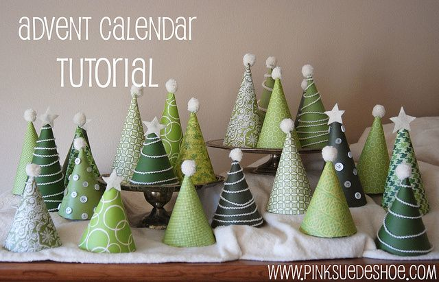 """DIY Advent calendar- I love this tutorial! (White felt cloth for """"snow"""", tiered platters for """"hills"""".)-- These would be easy to do a tissue paper punch out on the bottom, different hieghts, on top of the tv?"""