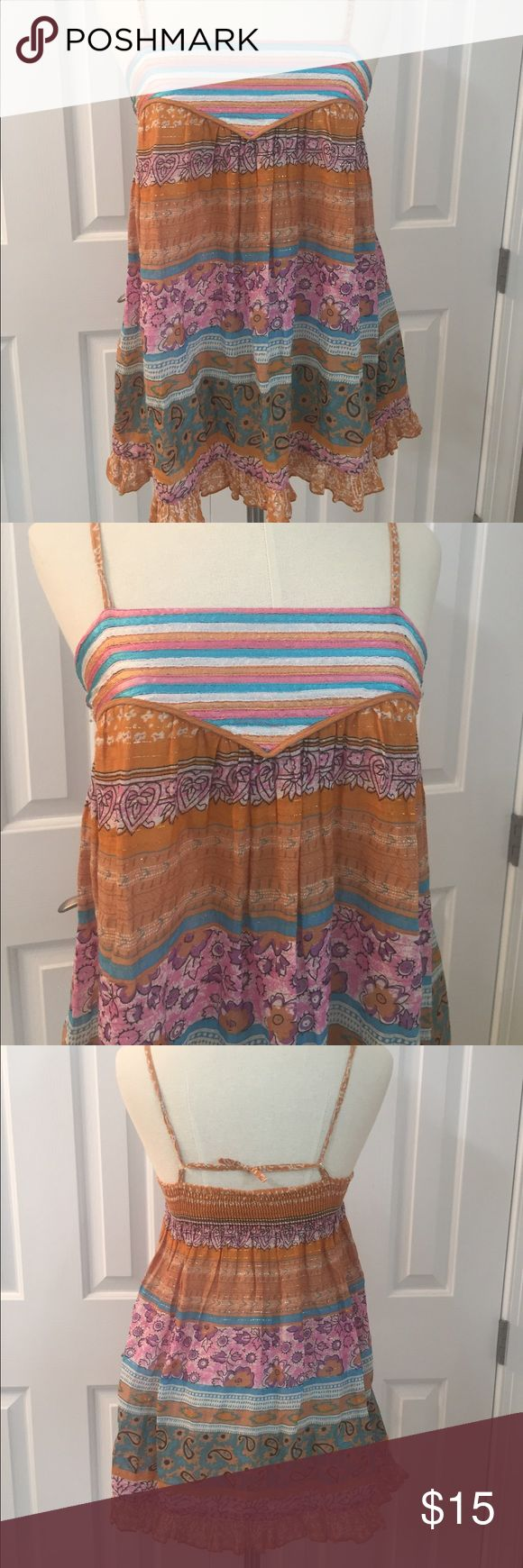 Daytrip BoHo Spaghetti Strap Adjustable Top Large Fun and Flirty multi print top with an elastic smocked back, and adjustable straps. Metallic threads weaved throughout the top make this an eye catcher. Size Large Preowned no visual flaws, good condition. Check out my closet to save on bundles. Reasonable offers accepted. Daytrip Tops