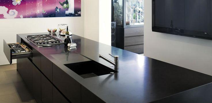 Kitchen I designed in Minotti Ccuine Gandhara furniture, dark oak units with Nero Assoluto worktop/sink.