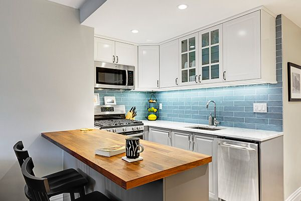 The bar counter was significantly enlarged, granting more prep and dining space and doubling the kitchen's drawer storage. And to accommodate a full-sized stove and fridge, Kelly moved the fridge out of the galley altogether.