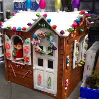 Turn an old plastic outdoor playhouse into a fun holiday gingerbread house