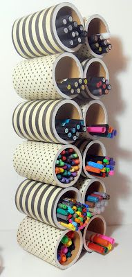 Cute storage idea ~ PVC pipe covered in contact paper or craft paper then hot-glued together.