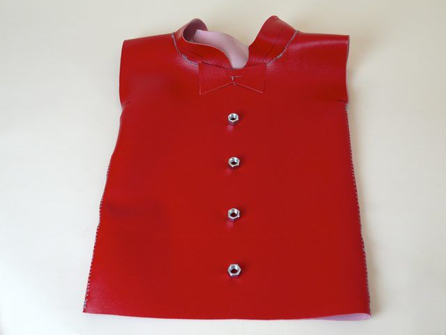 Make a Tin Man costume using vinyl fabric to give it a tin-like appearance. This variation shows how to make a tin-like skirt in place of pants.