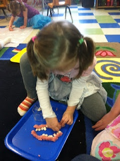 Dental health activities. Playdough and beans to make a smile. discoverykidzone....