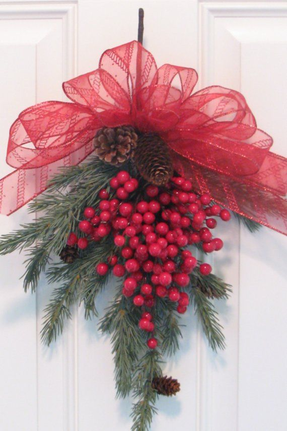 simple red and green Christmas decor...frothy ribbon, pine branch, and red berries