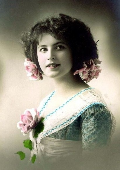 colored vintage photo of young girl with pink roses
