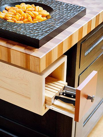 Drawers and Pullouts  From the Block  A small drawer containing a knife block is perfectly placed beneath the countertop where food preparation takes place. Knife blocks with slots for a variety of shapes protect the knife blades and the user.