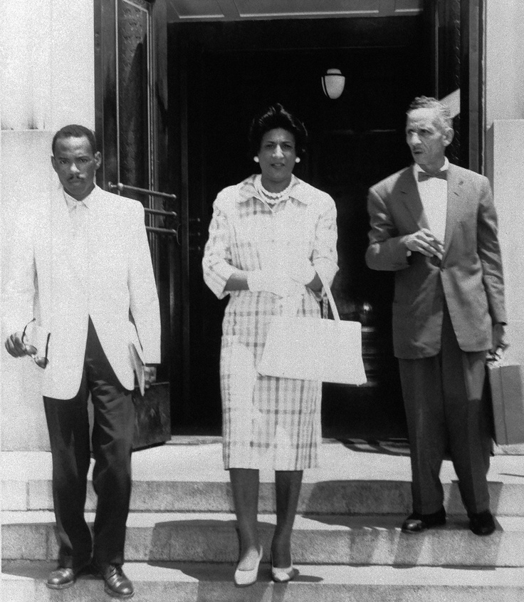 James H. Meredith, 28, left, leaves the courthouse in Meridian, Miss., on June 1, 1961 with his attorneys, Constance Baker Motley, New York, center, and R. Jess Brown, right, Vicksburg lawyer, after conferring with federal district judge Sidney Mize about his suit to enter the University of Mississippi. (AP)