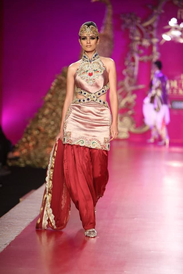 Hey you, classy Dhoti Salwars!  This year, Dhoti Salwars was one main attraction at the ramp. Ideal for Sangeet party or Mehendi ceremony, Dhoti Salwars are classy, traditional and yet stylish.