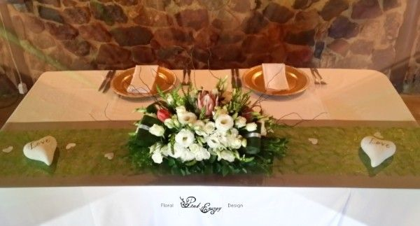 Sweetheart table / Main table - Floral piece with fynbos, proteas and lisianthus in white. River Place, Hennops River Valley, just outside Fourways, Johannesburg. Floral Design  by www.pinkenergyfloraldesign.co.za