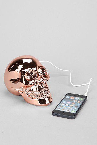 Rose gold skull speaker.