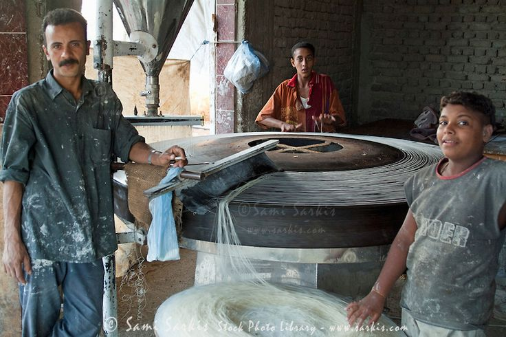 Portrait of a man and his young employees in a small noodle factory, Al-Qusair, Egypt.