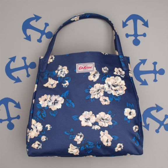 In the navy! Anchor up, and take a look at our new collection, Colour by Cath Kidston. This little number is called, It's Navy Baby.