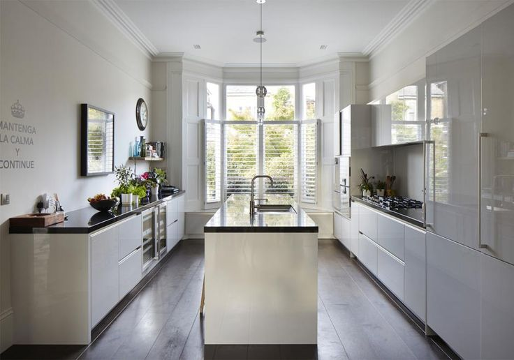 light filled contemporary kitchen contrasts with the period features in this refurbished home.