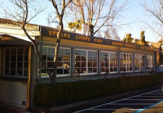 """Mustards Grill, Napa, Ca.  Soo good.  Must try their onion rings (they are more like strings, and NOT greasy) with home made """"ketchup"""" (it's puréed apples and tomatoes.  Omg, yum!). Husband loved the bacon wrapped rabbit.  Plus, there is a wine tasting room next door."""