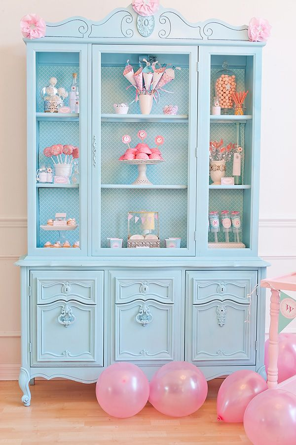 Aqua china cabinet used as a treat display.