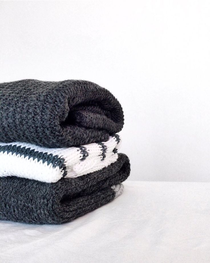 Stack of handmade sweaters » capsule wardrobe with neutral colors