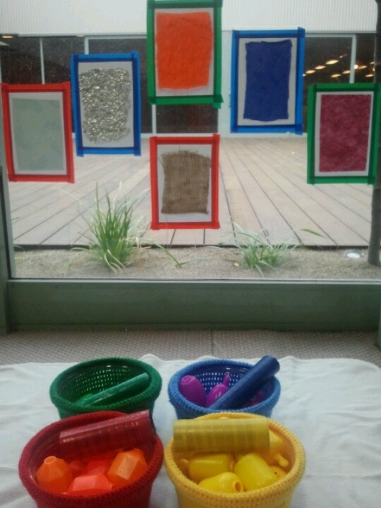 Tactile sensory boards taped to the window at toddler height and crochet baskets for colour matching (or they make great hats)