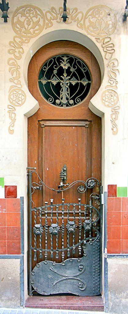 Art Nouveau door to Casa Francisco Cardús i Guilamany  1902 in Barcelona, Spain. - The  architect Lluí de Miquel i Roca