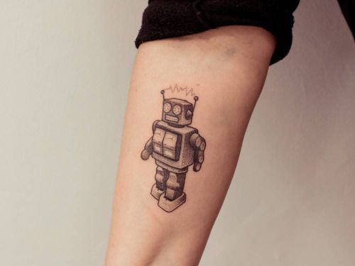 Hand poked robot tattoo on the right forearm. Tattoo artist:...