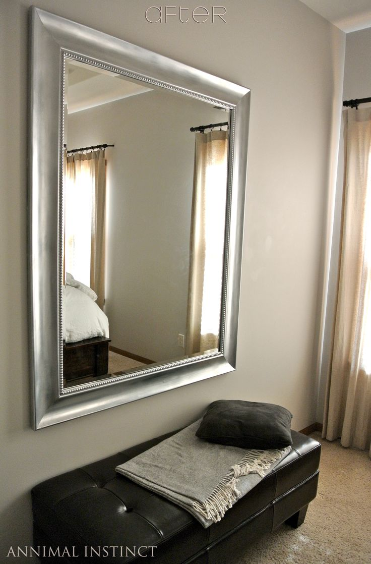 DIY paint job:  Black mirror frame painted silver & topped with rub 'n buff.  Looks like Restoration Hardware at fraction of cost! (for giving a more relaxed look to the master bedroom)