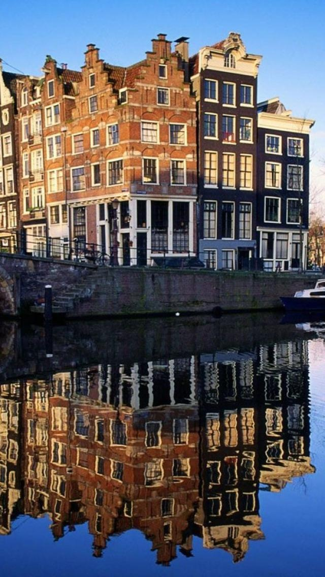 Netherlands - Amsterdam. Facts about Netherlands:Area: 41,785 sq km. Northwestern Europe occupying the Rhine delta; over 20% is below sea level. Population: 16,653,346. Capital: Amsterdam (administrative capital); The Hague (seat of government). Official language: Dutch (Nederlands), Frisian. Many also speak English. Languages: 38