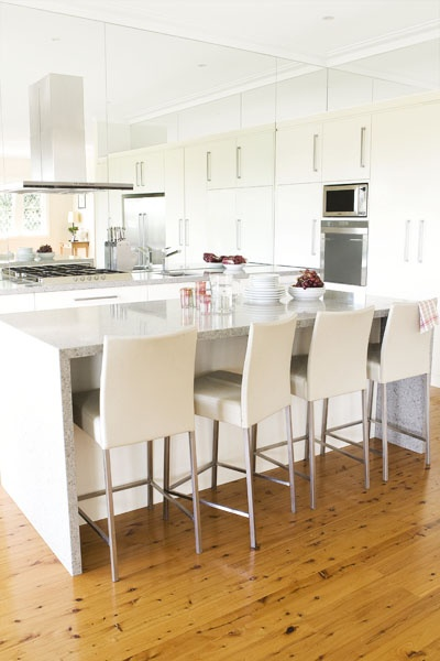 beautiful kitchen. i love the idea of the mirrored splashback extending to the ceiling