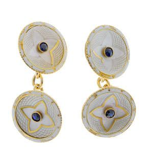 LOT:809   A pair of early 20th century 18ct gold sapphire, mother-of-pearl and enamel cufflinks.