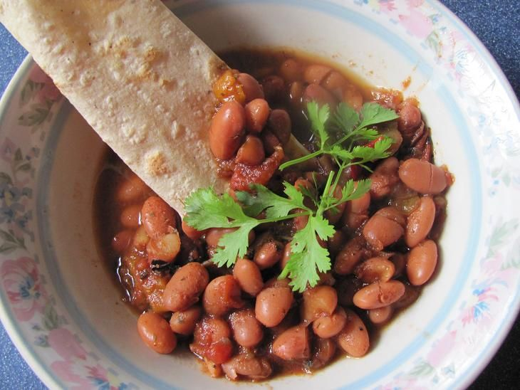 This recipe evolved from my mother-in-law's frijoles al charro. She makes hers with bacon to flavor the beans. I usually omit the bacon, especially when my vegetarian cousin comes to dinner. The ch...