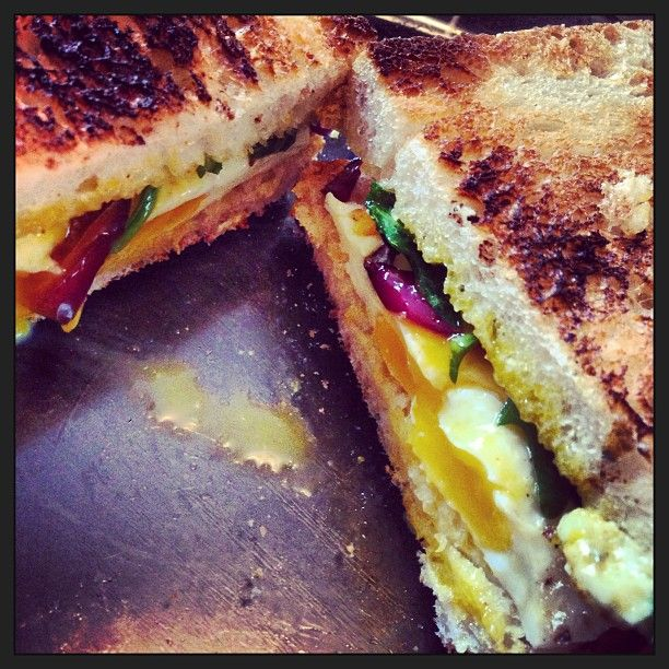 Homemade egg breakfast sandwich- Poached egg with sauteed red onion, arugula and goat cheese