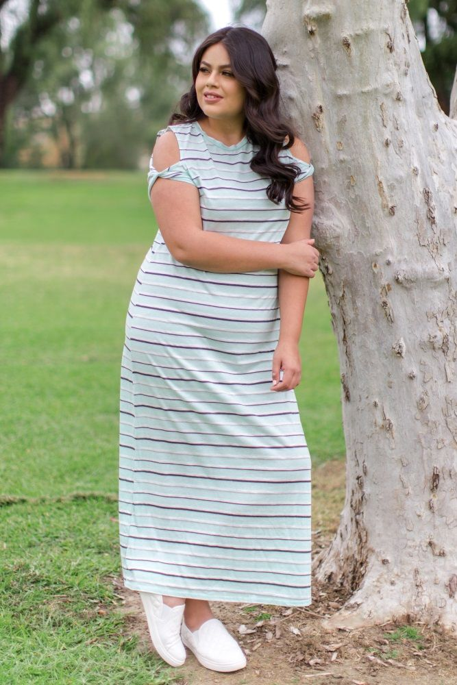 507826c1d3546 A striped cold shoulder plus size maxi dress. Twisted short sleeves.  Rounded neckline.