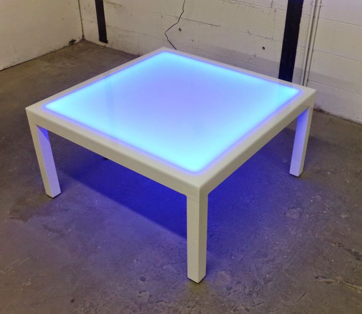 charming white table with elegant white color and features gorgeous blue light lit in dark and suitable for young children